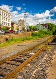 Railroad tracks and buildings on Main Street in Phillipsburg, Ne Stock Image