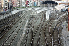 Railroad tracks and catenary. With crossings of roads and sidewalks. Bilbao, Spain. Basque Country Royalty Free Stock Photo