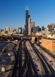 Railroad tracks into Chicago. Willis Tower viewed from the 18th Street Bridge near Ping Tom Memorial Park in Chicago, Illinois Stock Image
