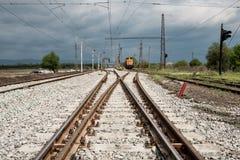 Railroad tracks closeup. With train Stock Photo