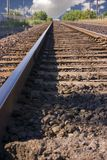 Railroad Tracks with Clouds in the Horizon Royalty Free Stock Photos
