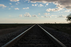 Railroad tracks converging Stock Images