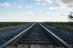 Railroad tracks converging Stock Photo
