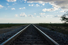 Railroad tracks converging Royalty Free Stock Photo