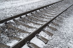 Railroad tracks covered with snow Royalty Free Stock Images