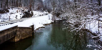 Railroad tracks and creek during the winter, in rural Carroll Co Royalty Free Stock Photos