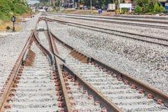 Railroad tracks crossing of a Public Thai Train Railway Royalty Free Stock Photo