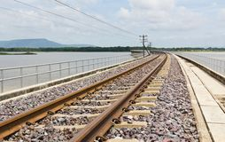 Railroad tracks curving Stock Image