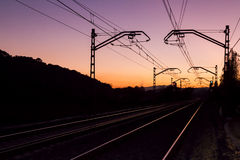 Railroad tracks and dawn dusk Royalty Free Stock Images