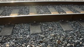 Railroad tracks during the day. Side shot of  Railroad tracks during the day stock footage