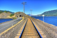 Railroad Tracks East Bound. Railroad Tracks heading east in the Columbia river Gorge with Drano Lake on the left and Columbia river on the right Stock Photos