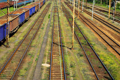 Railroad tracks and empty the wagons laden with cargo Stock Images