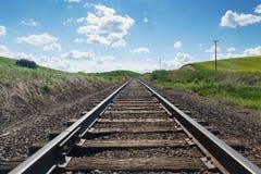 Railroad. Tracks through fields of canola, Colfax, Washington royalty free stock image