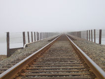 Railroad tracks into fog Stock Image