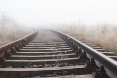 Railroad tracks in the fog Stock Photo