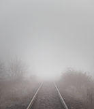Railroad tracks in the fog Stock Image