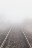 Railroad tracks in the fog Royalty Free Stock Photos