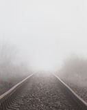 Railroad tracks in the fog Stock Images