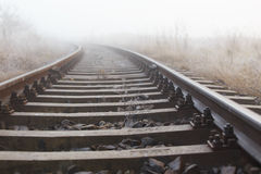 Railroad tracks in the fog Royalty Free Stock Images