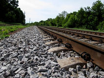 Railroad tracks go to the horizon, close-up royalty free stock image