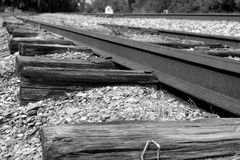 Railroad tracks going through broken stone Stock Photos
