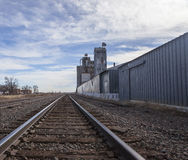 Railroad Tracks and Grain Elevator. Old railroad tracks along side an abandoned  grain silo Stock Image