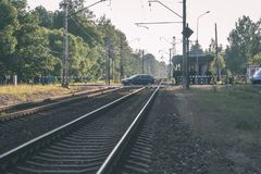 Railroad tracks and ground details - vintage retro film look. Railroad tracks and ground details in summer - vintage retro film look royalty free stock photography