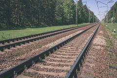 Railroad tracks and ground details - vintage retro film look. Railroad tracks and ground details in summer - vintage retro film look royalty free stock photo
