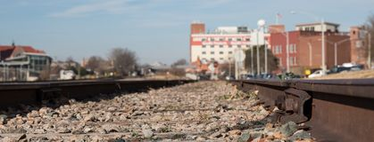 Close up view of railroad tracks in an urban setting. royalty free stock photos