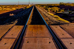 Railroad Tracks Heading North into New Mexico Desert. Royalty Free Stock Image