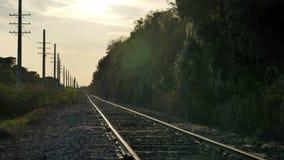 Railroad tracks heading into sunset, 4K stock footage