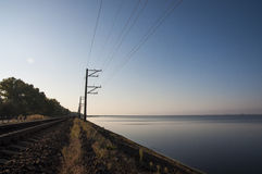 Railroad tracks. Lead across the lake Stock Images