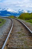 Railroad tracks leading into the Chugach mountains Stock Image