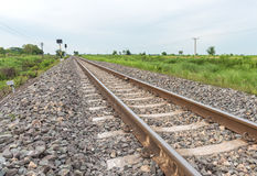Railroad tracks leading from right to left Stock Images