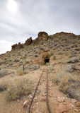 Railroad tracks leading to abandoned mine Stock Photography