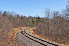 Railroad tracks leading to bend Royalty Free Stock Photography