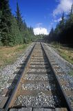 Railroad tracks leading to a snowy mountain off of Seward Highway in Kenai Peninsula, AK Stock Photography