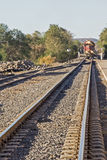 Railroad tracks with locomotive Stock Images