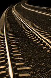 Railroad Tracks. Long bright, railroad tracks curving around bend royalty free stock images
