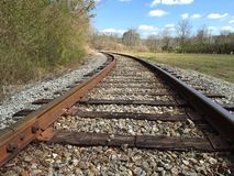 Railroad Tracks through a meadow Royalty Free Stock Images
