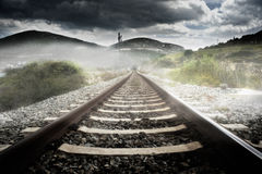 Railroad tracks in the mist Stock Photos