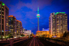 Railroad tracks and modern buildings at night, in downtown Toron Stock Image
