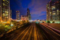 Railroad tracks and modern buildings at night, in downtown Toron Royalty Free Stock Images