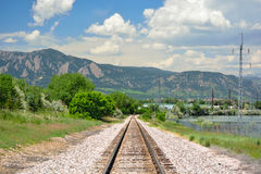 Railroad Tracks in the Mountains on a Sunny Day.  Royalty Free Stock Photo