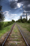 Railroad tracks in nature. In sunset Royalty Free Stock Photography