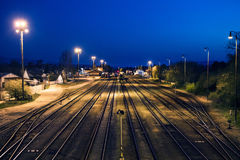 Railroad tracks near the depot under the night sky. Stock Photography
