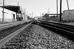 Railrocks near shipyards on theterfront. Low angle view of merging railroad tracks in an industrial area near the harbor and porilebama Stock Photo