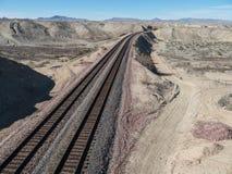 Railroad tracks in Northern Arizona. Railroad tracks run through the Nevada desert Royalty Free Stock Photo