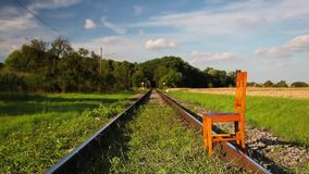 Railroad tracks and old wooden chair stock video