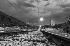 Railroad tracks passing a sign Stock Photos